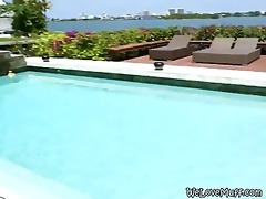 brunette hair lesbo three-some in swimming pool