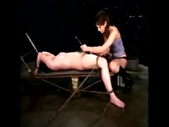 lesbo domme sits on a pale male serf
