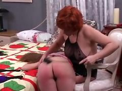 cute lesbian floozy domme spanks the hell out of