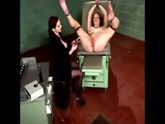 dominatrix uses a speculum on her bounded serf