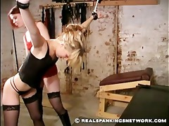 nice-looking golden-haired spanked by a dark