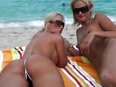 lesbo blondes at the beach licking cookie