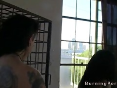 tattooed lesbos licking beside cage