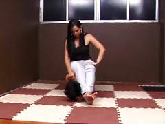 pretty brazilian domme playing with her pet serf
