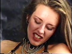 aged blond domme restrains brunette puma with